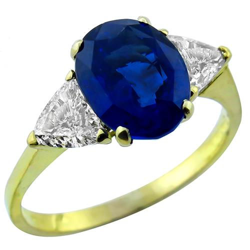 3.06ct Oval Cut  Ceylon Sapphire 0.60ct Trilliant Diamond  18k Yellow Gold Engagement Ring