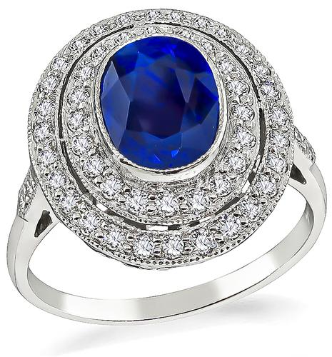 Oval Cut Sapphire Round Cut Diamond Platinum Ring
