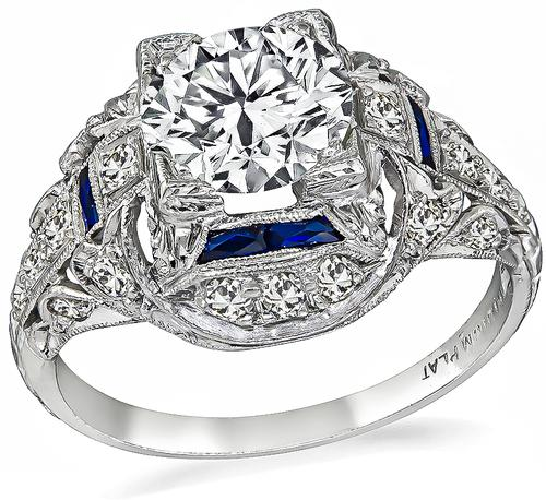 Vintage Round Brilliant Cut Diamond Sapphire Platinum Engagement Ring
